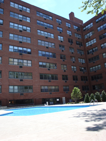 Rear View of building with pool at Bella Vista  Elizabeth  NJ. CRGLiving com   Offering the best deals and values on New Jersey